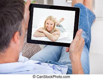 Man Video Chatting With Woman - Close-up Of A Man Video...