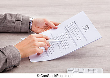 Businesswoman Holding Contract Paper - Close-up Of A...
