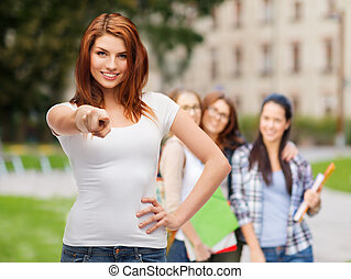 teenager in blank white t-shirt pointing at you - gestures...