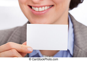 Businesswoman Holding Visiting Card - Portrait Of Smiling...