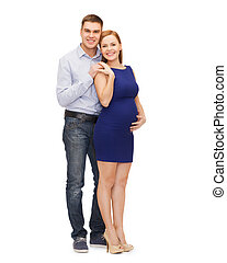 happy young family expecting child