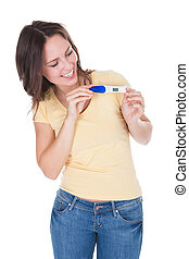 Happy Woman Looking At Pregnancy Result