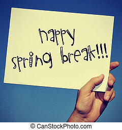 happy spring break - a man hand holding a signboard with the...