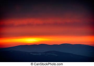 beautiful sunset over mountain peaks