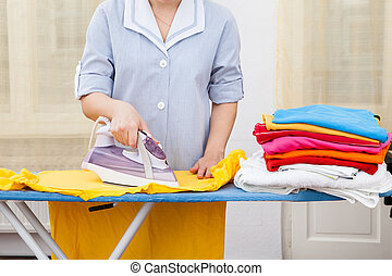 Maid Ironing Clothes - Close-up Of Maid Ironing Clothes On...