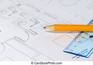 Pencil over a Blueprint - A pencil and a ruler on top of...