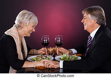 Senior Couple In A Restaurant - Happy Senior Couple Dining...