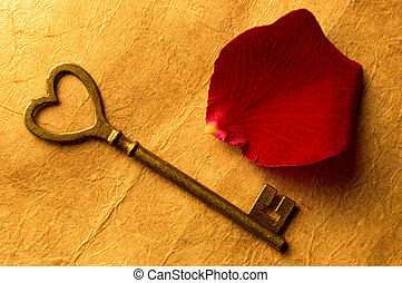 Key to heart - Antique key in the shape of a heart symbol...