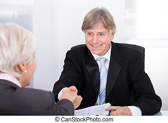Two Businesspeople Shaking Hands - Happy Mature Businessman...