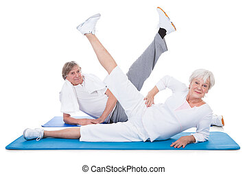 Senior Couple Doing Exercise - Happy Senior Couple Doing...