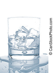 Water with ice cubes - Glass of fresh mineral water with ice...