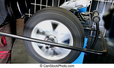 Automotive, service - Balancing of car tire in service