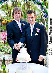 Two Grooms Cutting Cake at Their Wedding