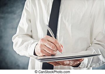 Businessman writing notes or signing document. Close up...
