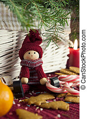 Decorative wooden doll on christmas background. Close-up. -...