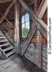 Interior of an abandoned wooden house with staircase