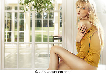 Blonde lady in the luxury house