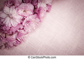 Cherry blossoms on pink linen - Pink linen fabric background...