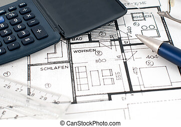 Floorplan with calculator, ruler and pen