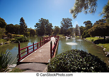 Bridge on the background of the pond in Japanese garden