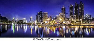 City town at night, Bangkok, Thailand in King celebration.