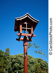 Japanese lantern on a background of blue sky