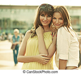Two smiling girlfriends with summer make-up - Two cheerful...