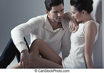 Handsome man touching soft skin of woman