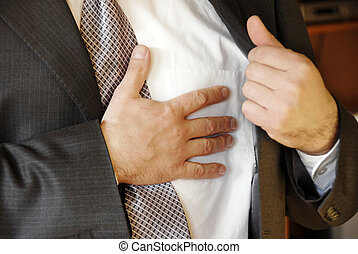 stressful job troubles - businessman hand on chest,...
