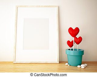 frame picture and flower pot on wood floor