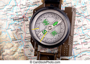 Compass on modern map - steel compass on travel map of...
