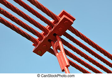 Steel lines of the bridge against the blue sky