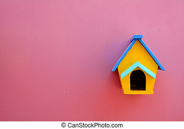 Decorative nesting wood box on violet wall background