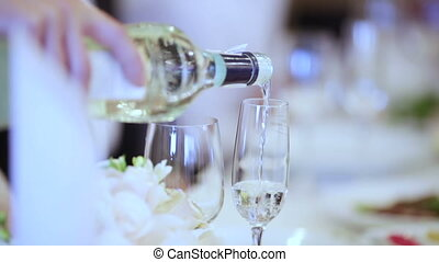 Spill champagne - Waiter pours champagne honeymooners Bridal...