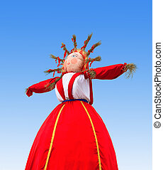 Shrovetide in Russia Big doll for the burning on blue sky...
