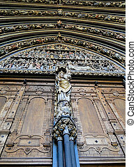 entrance of a cathedral with statutes - entrance of a...