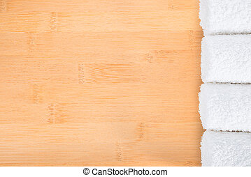 white towels on bamboo wooden  background