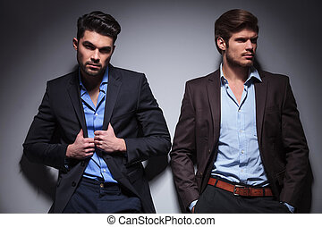 two relaxed fashion male models, one looking at the camera...