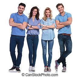 full body picture of four casual young smiling people - full...
