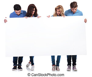 casual people holding and looking at a blank board - full...