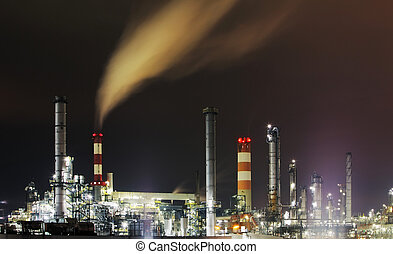 Oil Refinery at night with smoke stack