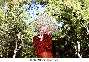 Extraordinary Hairstyle. Woman in Sumptuous Art Wig with...