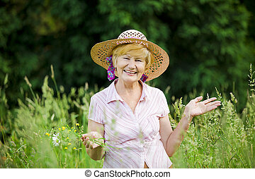 Joy Friendly Happy Mature Woman in Straw Hut with Stretched...