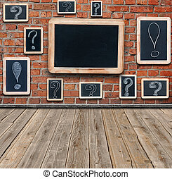 Question marks and exclamation marks white chalk drawing on...
