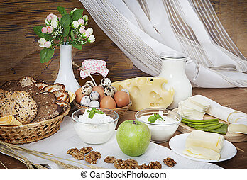 Lunch - Still life of dairy products with bread, honey and...