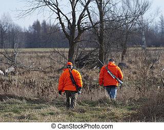 Deer Hunters - Deer hunters heading out to hunt