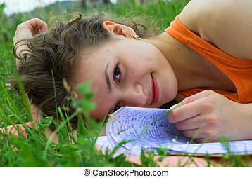 Study - Young female student is preparing for exam