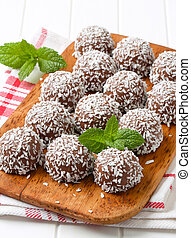 Chocolate coconut balls - Chocolate snowball truffles rolled...