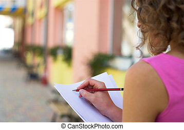 Businesswoman is preparing for annual report outdoors