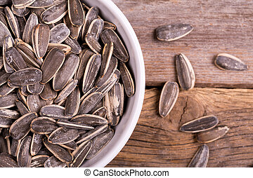 Sunflower seeds in a bowl - A bowl of roasted and salted...
